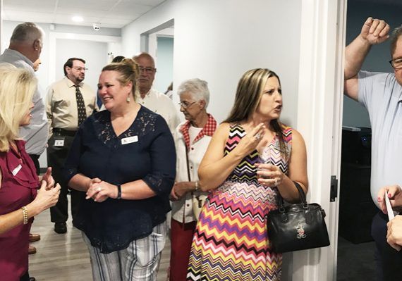 Attendees of Prevent Child Abuse Rowan and the Terrie Hess House's celebration of their new space/ addition enjoy conversation after being provided a tour. (Terrence Jefferies / Salisbury Post)